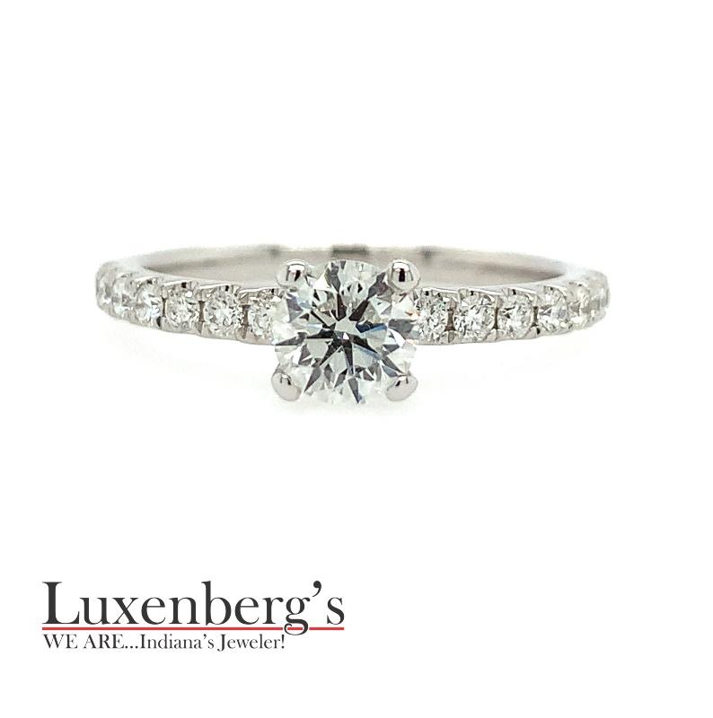 Round Brilliant Center with Shared Prong Sides Engagement Ring