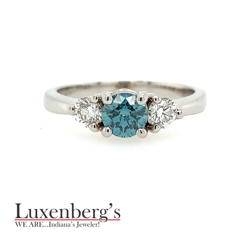 Blue Diamond with White Sides Engagement Ring