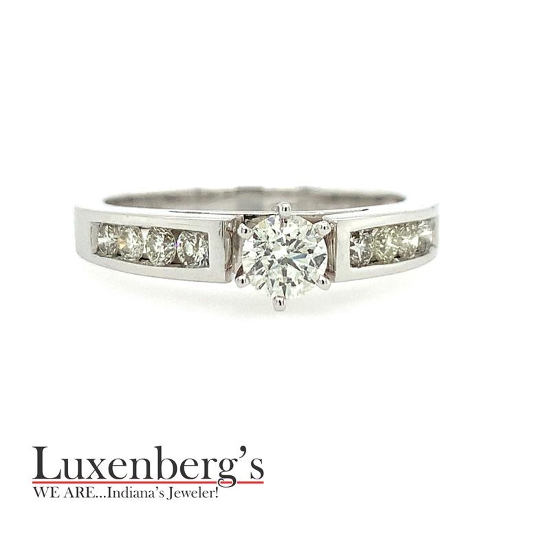 Round Center with Channel Set Engagement Ring