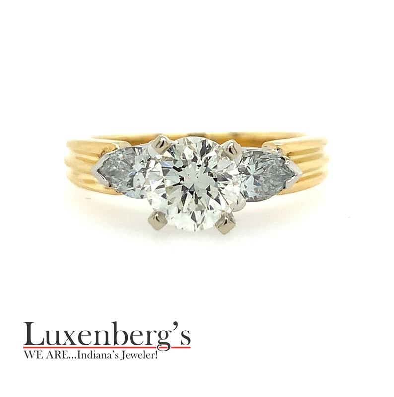 Round Diamond Center with Trillion Cut Sides Engagement Ring