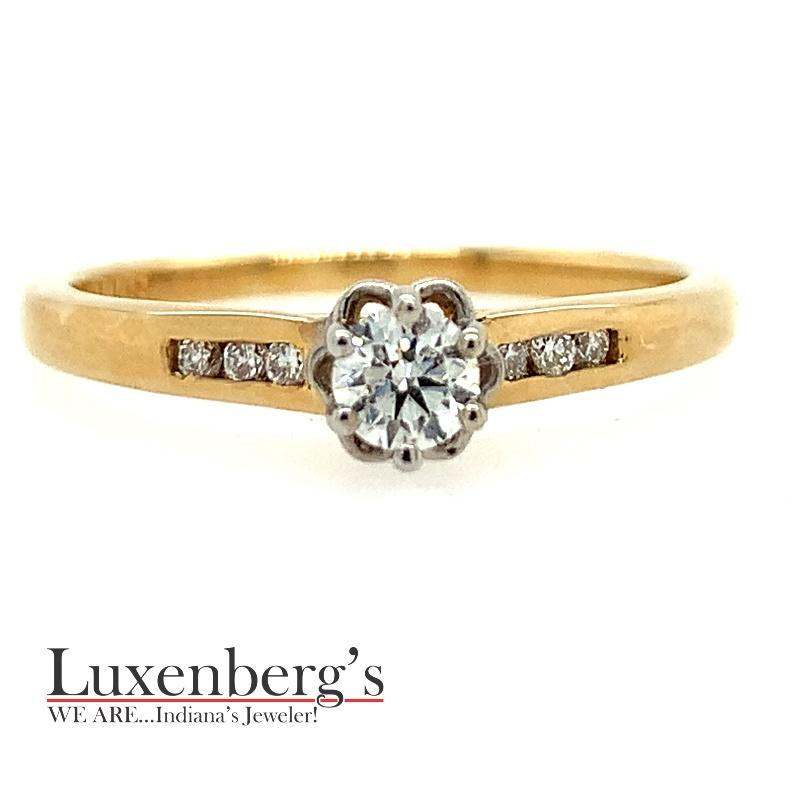Diamond Illusion Center with Channel set sides Engagement Ring